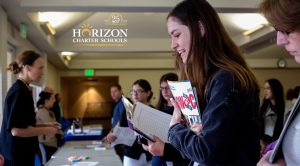 High School Student attends Horizon Charter Schools College and Career Fair.