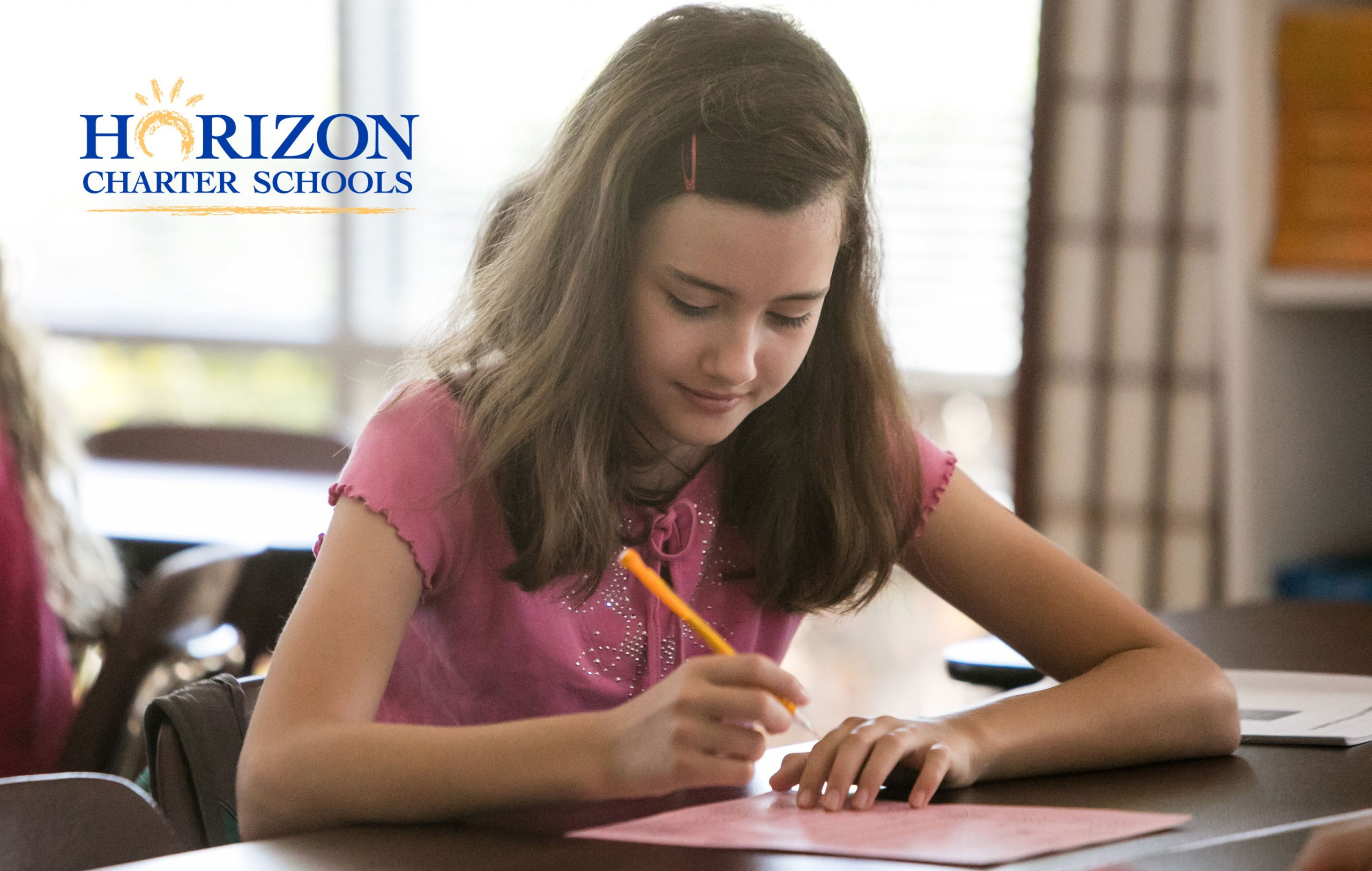 A Horizon Charter Schools student works on a written report.