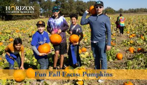 Horizon students display their pumpkins during a school field trip
